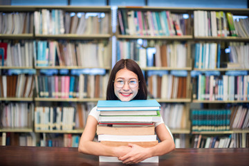 education, school and people concept - Cheerful university students with happy read a book and report in Library.; Asia university.