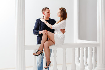woman hugging man on white background, beautiful young couple