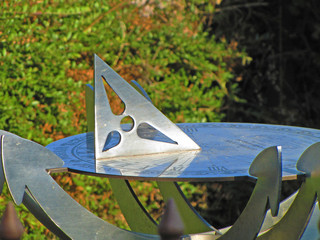 Sundial in summer day on tree background