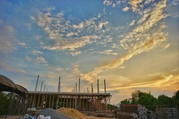 Lanscape of construction site with cloud and twilight sky.