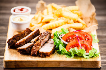 Grilled beefsteak with french fries and vegetables