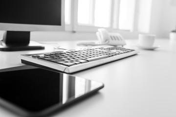 Blank tablet, keyboard and desktop computer