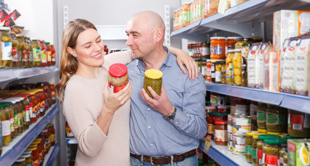 woman and man   holding pickle goods