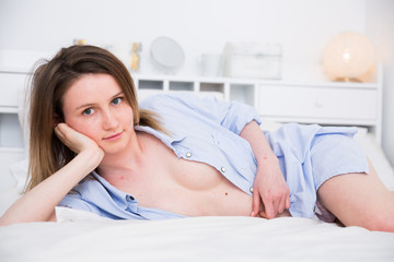 Nudity young female in blue shirt playfully posing and relaxing