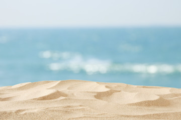 Empty sand beach in front of summer sea background with copy space.