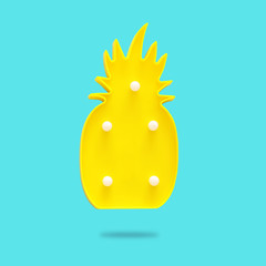 a plastic pineapple lamp with leds over mint background. holiday summer concept.