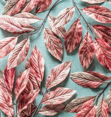 Wall Mural - Beautiful pink white tree leaves pattern on pastel blue background , top view, flat lay. Nature concept
