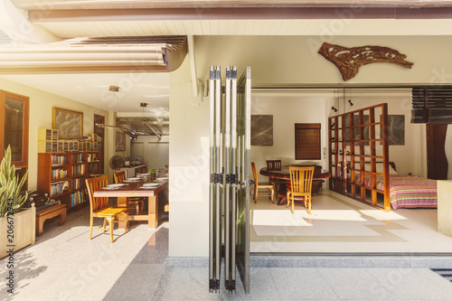 Big Open Dining Room With Bookshelf And Bedroom Folding Doors In Luxury Villa Hotel Resort