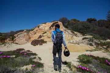 Traveller man walking on beautiful beach, enjoy motor travel holiday. Algarve, Portugal