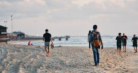 People on the beach in Tel Aviv.