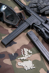 airsoft gun with protective glasses and lot of bullets