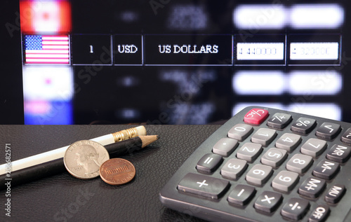 Coin Of United Stage America With Calculator And Pencil On Black Floor Digital Board