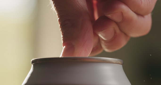 closeup man hand open white can with beverage