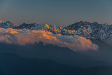 Rays of sunset on the tops of the mountains on a sunny day - China,sichuan