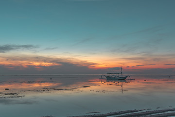 An old traditional indonesian fishing boat at sunrise