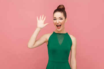 Wel hi! Perfect woman showing hello sign, toothy smiling