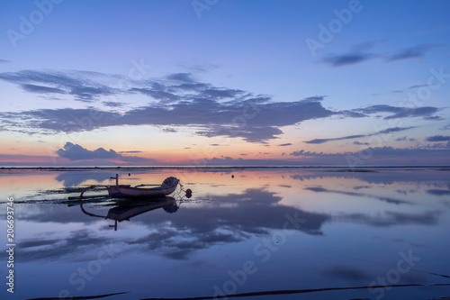 traditional balinese fishing boat in the first blue morning