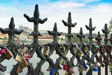 lovers on a fence rail locks from the river