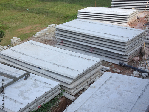 Precast concrete slab fabricated at factory and delivered to