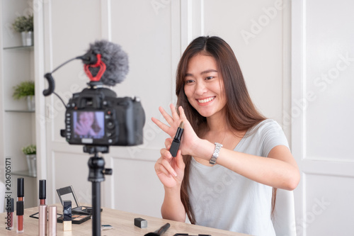 Asian Young Female Blogger Recording Vlog Video With Makeup Cosmetic