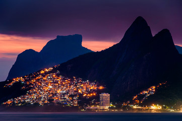 Lights of Vidigal Favela in Rio de Janeiro, at Night, With Mountains