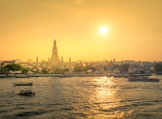 Wat Arun at sunset time ,Bangkok, Thailand. The Temple of Dawn,The boat was sailing in Chao Phraya River Bangkok ,The Chao Phraya is the major river in Thailand