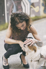 woman caressing a puppy