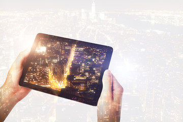 Hand photographing city with tablet
