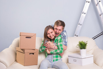 Young cheerful couple moving into their new home