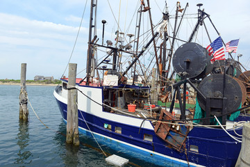 Commercial fishing boat near dock before sailing into the ocean