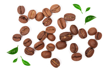 Coffee beans decorated with green leaves isolated on white background. Top view