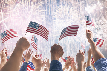 Hands of people holding the Flags of USA.