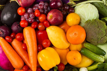 Wellness of Diet program with healthy eating vegetable and fruits, red green orange and purple color of mixed vegetable background