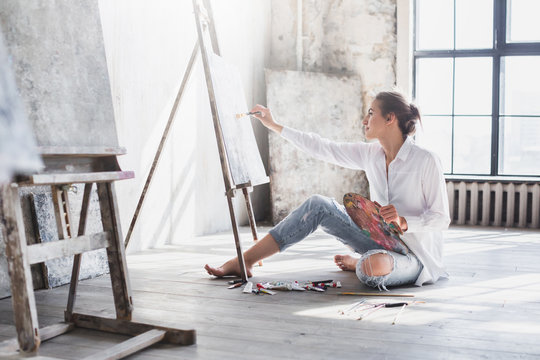 Woman painter at workspace.