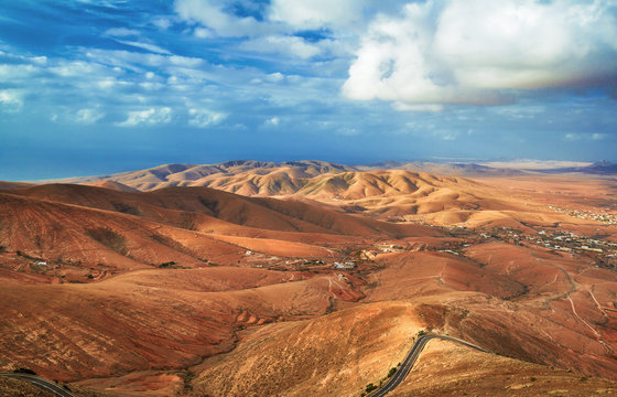 Fuerteventura mountains in clouds on sunny day, mirador de Morro Velosa, Fuerteventura, Canary Islans, Spain