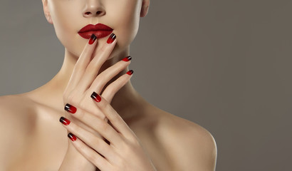Beautiful model girl with red and black french manicure on nails . Fashion luxury makeup . Beauty and cosmetics .