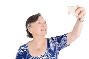 Beautiful senior woman taking a selfie