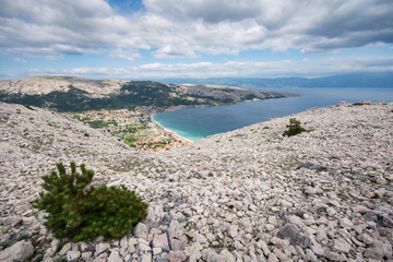 Baska on Island of Krk, Croatia, seen from the top of the karst ridge surrounding it, with the moon-like surface and very little vegetation.