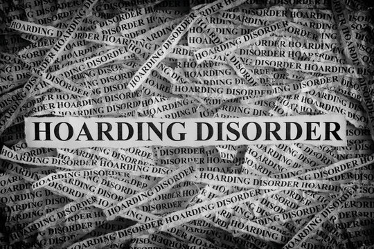 Torn pieces of paper with the words Hoarding Disorder
