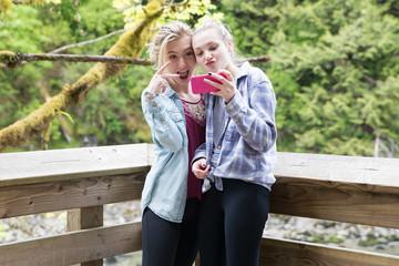 teenage girls taking a selfie