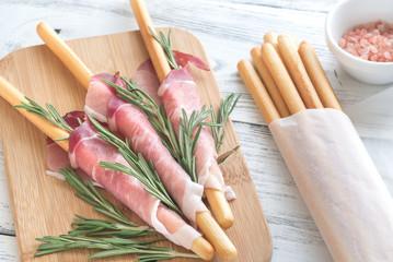Breadsticks wrapped in ham