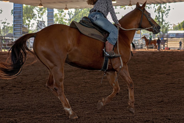 Horse Rider In Barrel Racing Event At An Indoor Country Rodeo