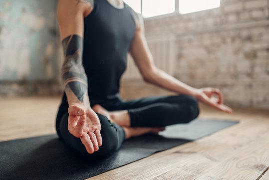 Male yoga, meditation in asana position
