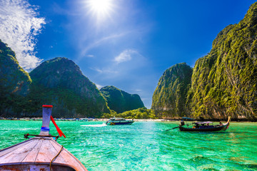 Clean water of Maya bay, traditional long tail boat in Ko Phi Phi Lee island - Thailand