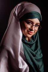 close up portrait of female Muslim student in round glasses