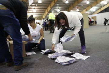 Tables close at polling stations as Colombians vote for a new president in Bogota