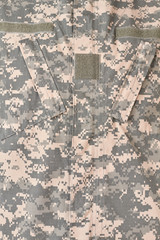 Military uniform texture. Vertical cropped image.