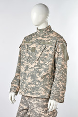 Mannequin in camouflage uniforms. White isolated background.