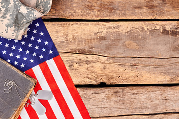 US army soldier's accessories with copyspace on wood. Gather of patriotic american soldier's items.