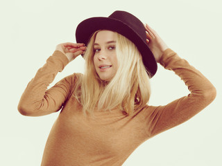 Woman wearing suede and black hat